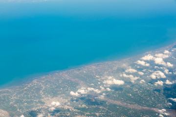 Beautiful aerial view over an Island from the airplane