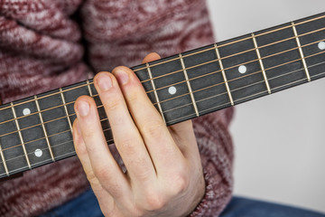 detail of fingers and hand of guitar player