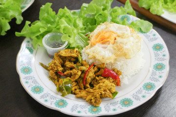 rice, stir fried hot and spicy curry with chicken and fried egg