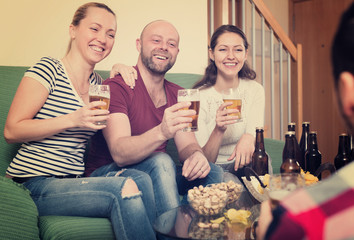 Friends hanging out with beer