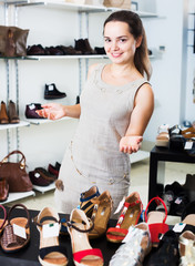 Female seller in shoes shop