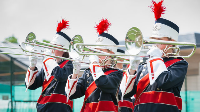 Show band with live music playing wind instruments in uniform, t