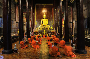 Buddhist monks pray and meditate every day evening at Wat Phan Tao in CHIANG MAI THAILAND.