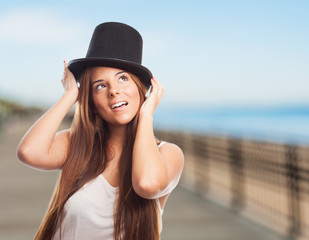 pretty girl wearing a vintage top-hat and thinking about somethi