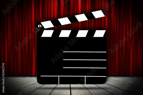 cinema voucher pattern black clapperboard in front of stage with red ...
