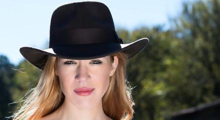 Blonde Female In Black Hat Outdoors