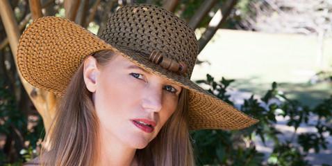 Blonde Female In Brown Hat