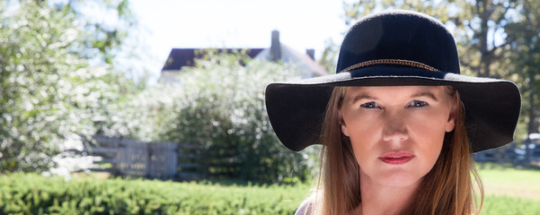 Blonde Female in Black Hat