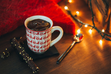 Cup of hot chocolate with Christmas lights