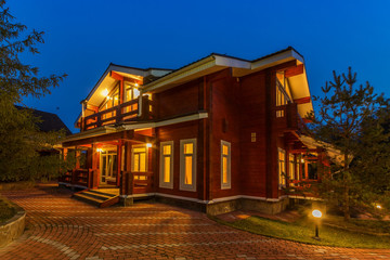 Nice modern wooden house during evening hours.