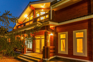 New modern log house exterior at dusk