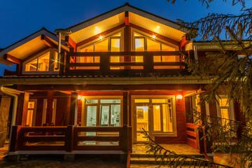Modern wooden home exterior at dusk