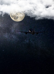 Airliner flying in the night, starry sky and moon