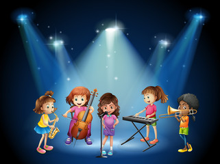 Children playing music in concert