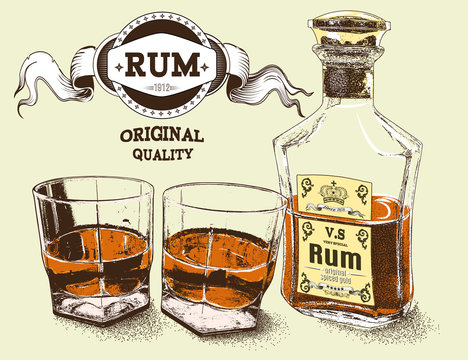 Two stemware of rum with bootle