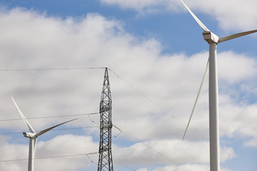 Wind turbines and power line. Clean alternative renewable energy