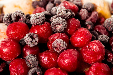 Close up of frozen mixed fruit, berries - cherry, raspberry, bla