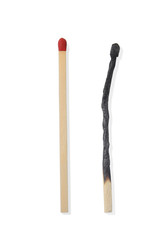 Two Wooden Matchsticks or Matches with one Burnt on a White Back