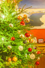 Decorated and illuminated Christmas tree on indistinct, blurred and  fairytale background.