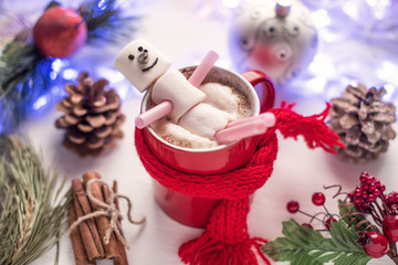 Christmas drink. Hot chocolate with marshmallow snowman in red cup
