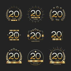 Twenty years anniversary celebration logotype. 20th anniversary gold logo set.