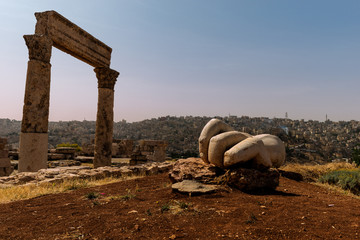 ruins of the Hercules temple on Amman, Jordan. Hercules hand at the antique Citadel, Amman, Jordan.