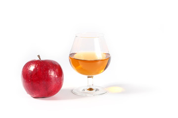 Lovely fresh ripe apple and a glass of strong alcohol