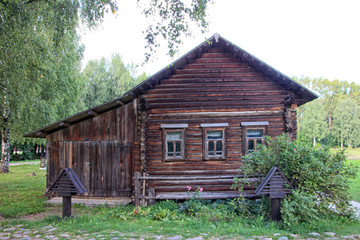 beautiful vintage traditional Russian log house with wooden wind