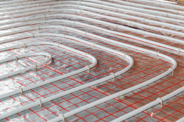 Underfloor heating installation. Close up on water floor  system interior. plumbing pipes. Individual .