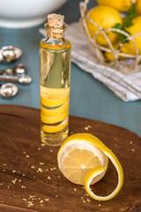 Homemade lemon extract made by infusing lemon peel in vodka