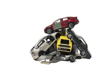 Still Life of a Pile of Used Model Wrecked Cars in a Junkyard on