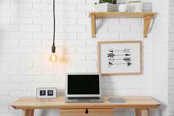 Work place interior design with light bulb on wire