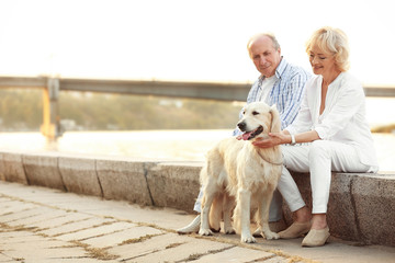 Senior couple and big dog on bund