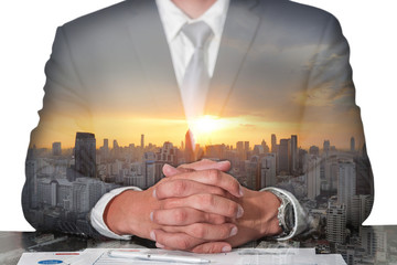 Double exposure of businessman fingers crossed and sit down, cityscape and sunset as meeting, commitment and business concept.
