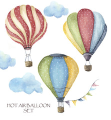Watercolor hot air balloon polka dot set. Hand drawn vintage air balloons with flags garlands, clouds and retro design. Illustrations isolated on white background