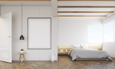 Bedroom with sofa and framed poster