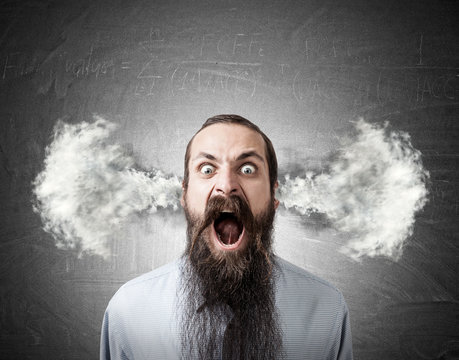 Shouting man with steam from ears