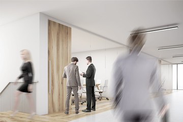 Man entering office with lots of people