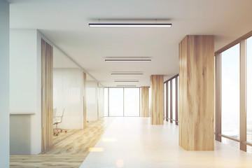 Office with wooden columns and conference rooms, toned