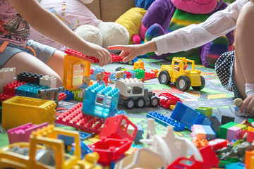 small children playing in kindergarten with colorful toys and Le