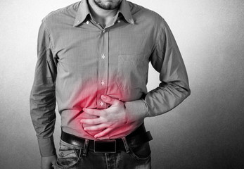 Man has a stomach pain