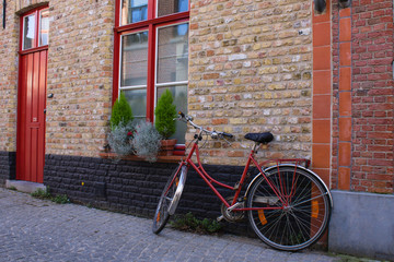 Red bicycle on the street of Bruge, Belgia