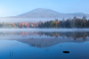 Blue Mountain reflecting on misty Lake Durant at sunrise in autumn