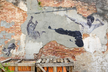 PENANG, MALAYSIA - APRIL 18, 2016: General view of a mural 'The Real Bruce Lee Would Never Do This' painted by 101 Lost Kittens in on JULY 6,2013.