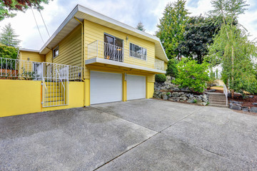 House exterior with yellow clapboard siding