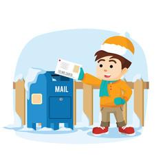boy sending letter to santa