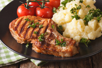 Grilled pork steak with mashed potatoes close-up. Horizontal