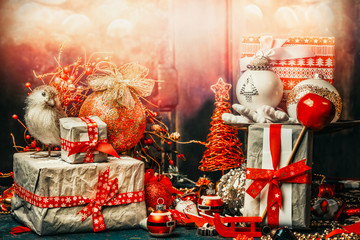 Pretty Christmas card with festive gifts, bird,decoration and balls . Holiday bokeh lighting, retro styled