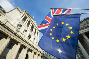 European Union and British Union Jack flag flying in front of the Bank of England as symbols of the financial repercussions of the Brexit EU referendum