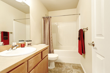 Bathroom interior in beige and brown colors.